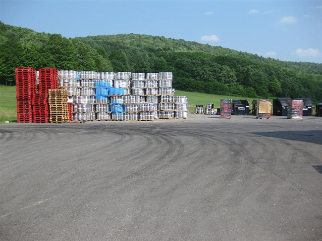 Warehouse on the left, brewery on the right. This area will have the reefer trucks for the beer and should effectively block cars from getting onto the field