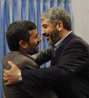 Iranian President Mahmoud Ahmadinejad, left, hugs Damascus-based Hamas chief Khaled Mashaal, as he welcomes him for their meeting at the presidency in Tehran, Iran, Sunday, Feb. 1, 2009. (AP)