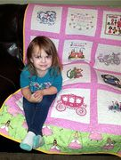 Brielle with her quilt