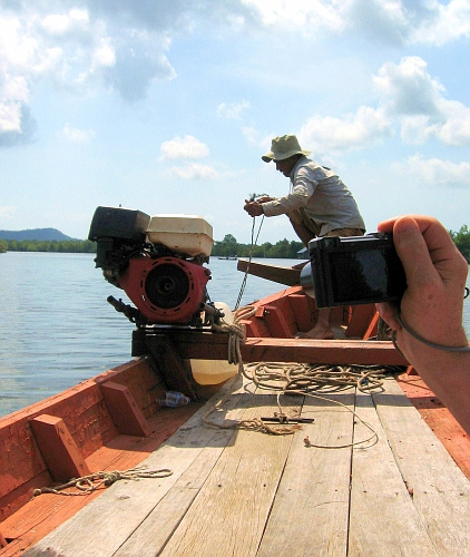 Boatman rigs up his engine