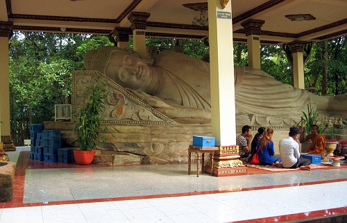 Large reclining Buddha, with meditation session going on.