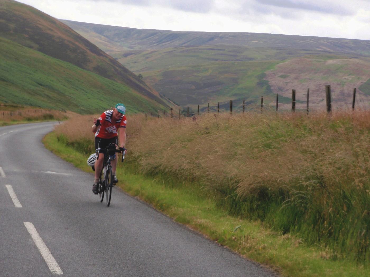 Road through Scottish hills on the way back
