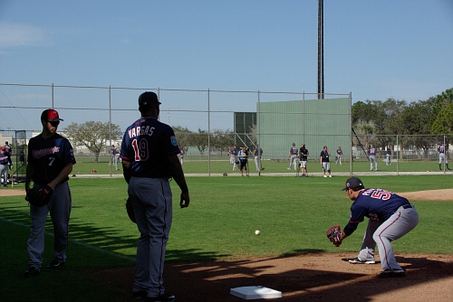 IMGP9828.JPG-Joe Mauer and Kennys Vargas look on as Byung Ho Park is fielding the ball