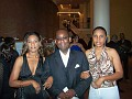 Entrepreneur Pierrot Mondésir in the company of 2 haitian beauties.