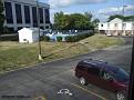 Utsikt över poolen och vår hyrbil från vårt motellfönster. Motel 6 i Dayton, Ohio.