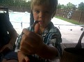 Patrick and the Wooly Worm on his thumb. He has just been amazed playing with that worm.