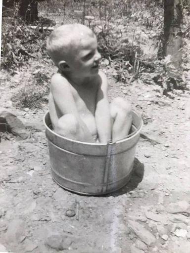 Terry Sharpe in a washtub
