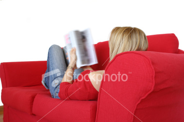 ist2 3746557-woman-on-red-sofa